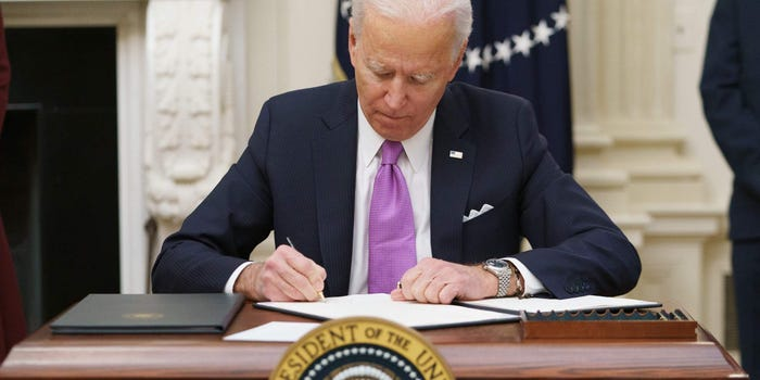Biden signining an executive order - Photo Business Insider