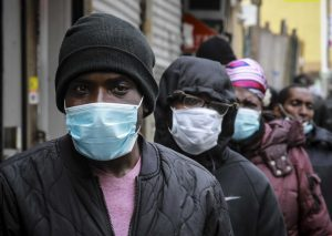 People wait for distribution of masks in New York