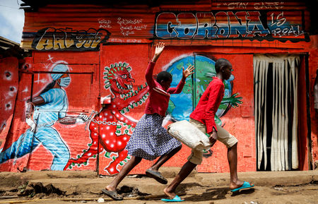 Informational mural in the Kibera slum, Kenya - Photo AP Brian Inganga