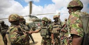 Kenyan Security Forces with chopper in background - Photo Strategic Intelligence Services