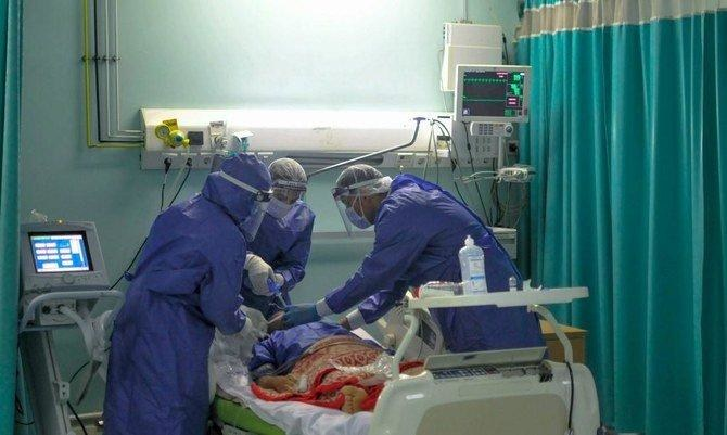 Medical Staff Attend to COVID-19 Patient