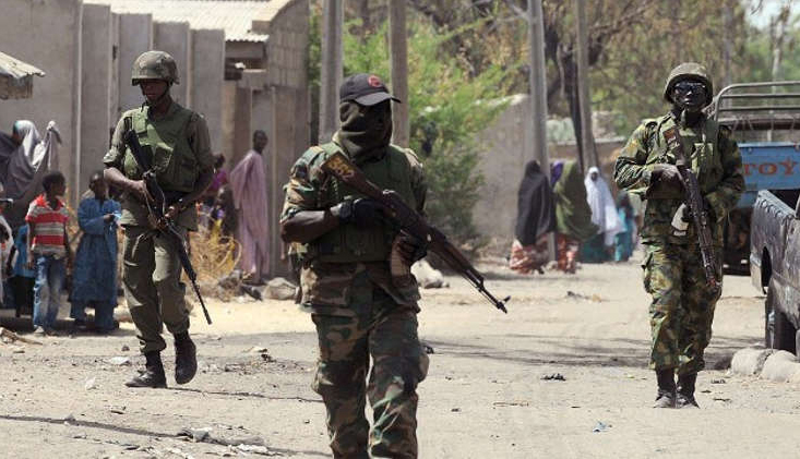 Nigerian Soldiers Retake Army Base - Photo AFP PHOTO/PIUS UTOMI EKPEIPIUS UTOMI