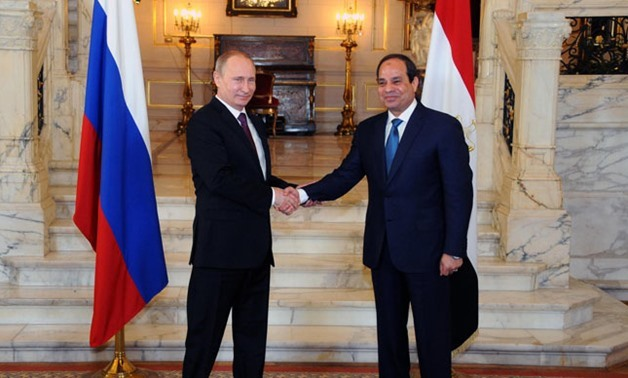 Putin (Left) and Sisi shaking on more of the same