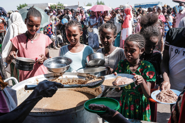 Ethiopian refugees from Tigray at soup kitchen in Sudan - Photo by Yasuyoshi CHIBA / AFP