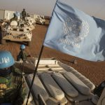 UN peacekeeper rides armored vehicle in Mali