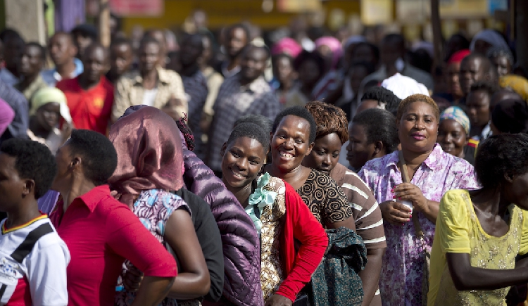 Ugandans packed close in long lines await turn to vote before COVID