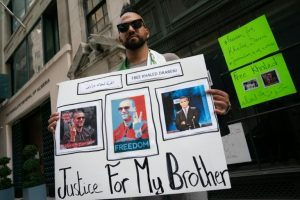 Brother of Jailed Journalist Protesting his Imprisonment - Photo Yahoo News