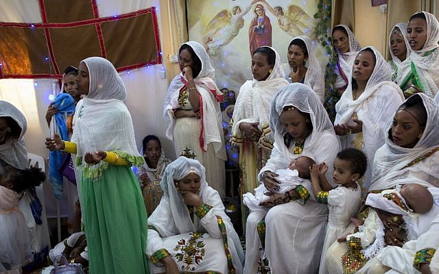 Eritreans at a Baptism Ceremony - Photo Stand for Cjhristians