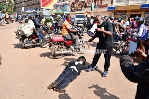 Man Arrest for Beating Museveni's Effigty - Photo Africa Feeds