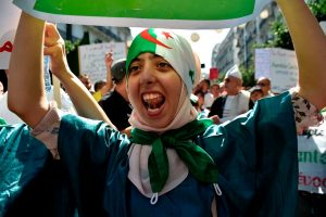 An Algerian Woman during the 2019 Protests - Photo Ryad Kramdi, AFP via Getty Images