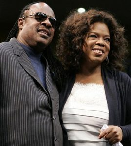 Stevie and Oprah - Photo African American Golfers Digest