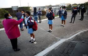 Students in South Africa getting temperatures checked - Photo Voice of America