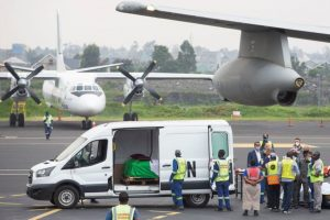 UN Van Conveys Remains of Envoy to Plane - Photo US News & World Report