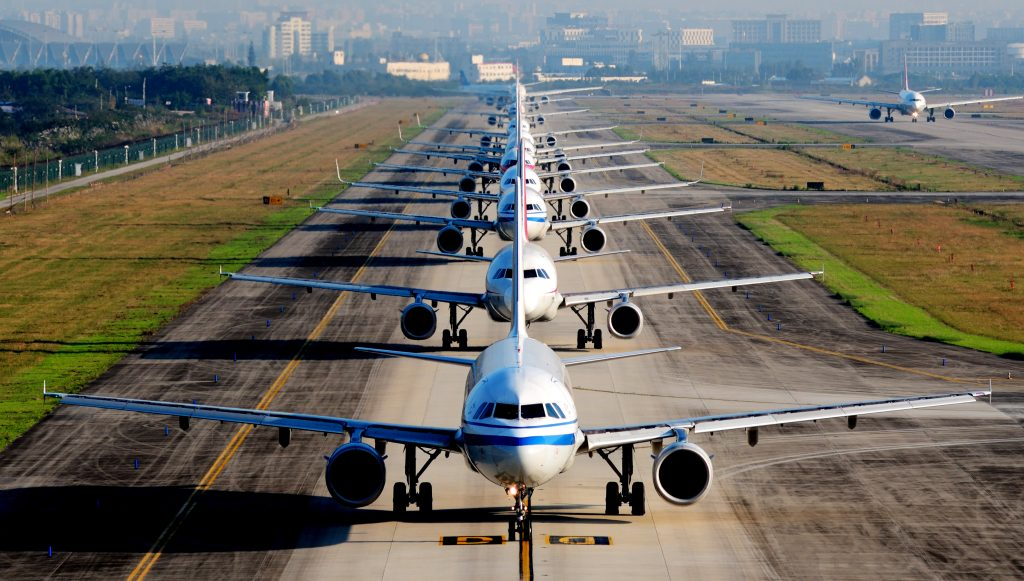 Airplanes in Line Awaiting Takeoff on Runway - Photo United Nations News