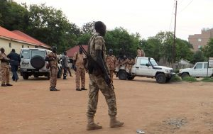 South Sudanese policemen seen along a street - Photo Reuters Stringer
