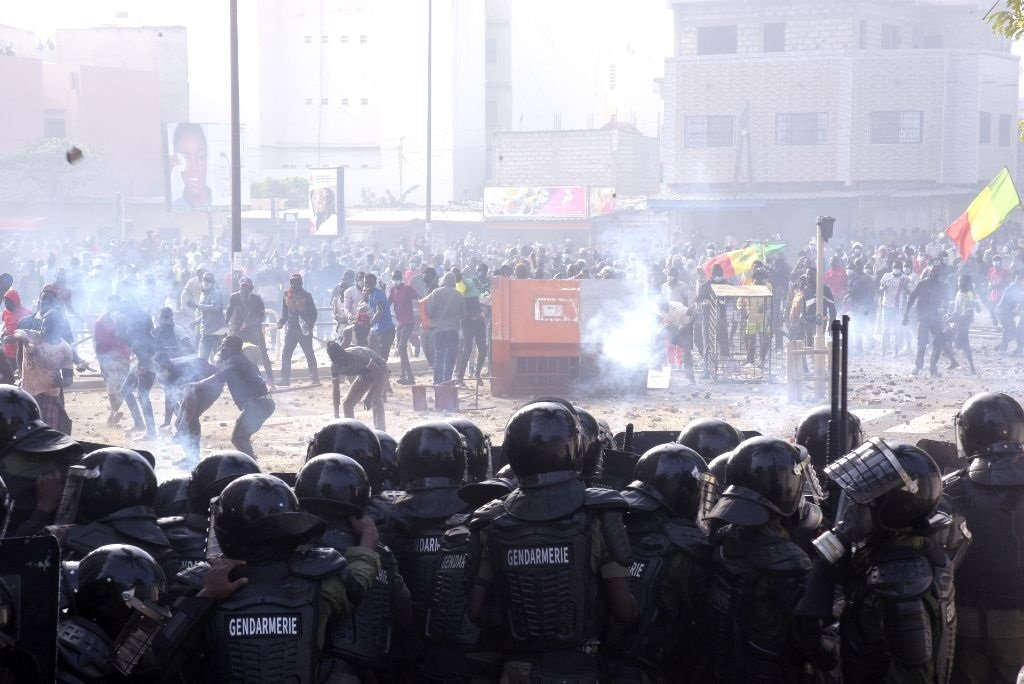 Angry Protesters Fight Running Battles with Riot Police in the Streets of Dakar - Photo News24