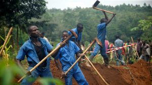 Exhuming Remains from Mass Graves - Photo The Independent