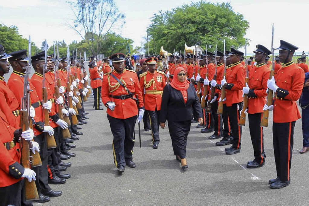 Tanzania's new president Samia Suluhu Hassan Inspects Guard of Honor Friday, March 19, 2021 after being Sworn-in - Photo AP