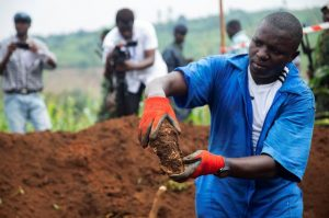 Mass Graves Reveal their Contents - Photo Reuters