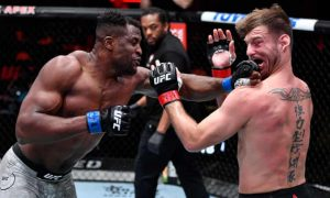 Ngannou Throws a Left Jab Overwhelming Stipe Miocic - Photo The Guardian