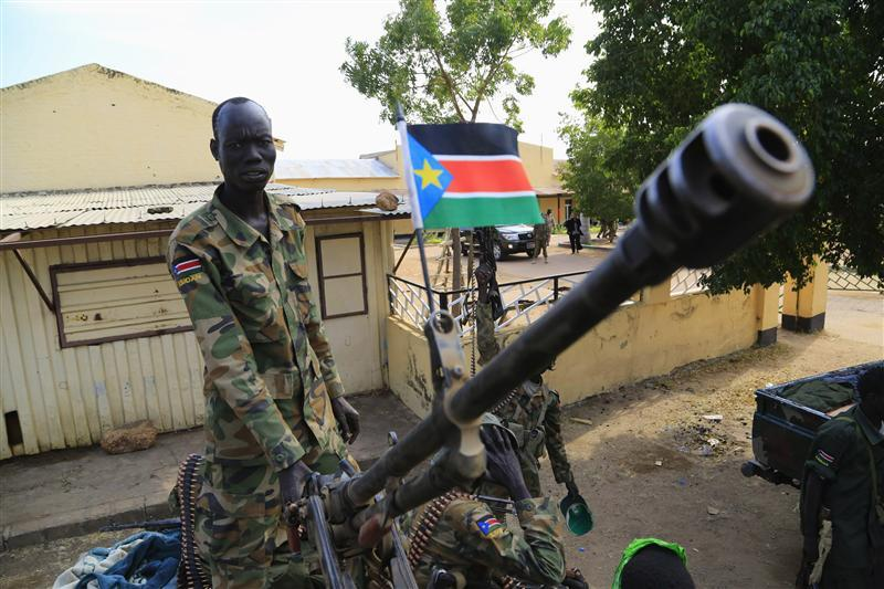 South Sudanese Soldier Stands Guard on Combat Tank - Photo Reuters