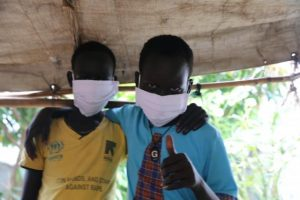 Young Boys Keep Their Masks On - Photo UNICEF