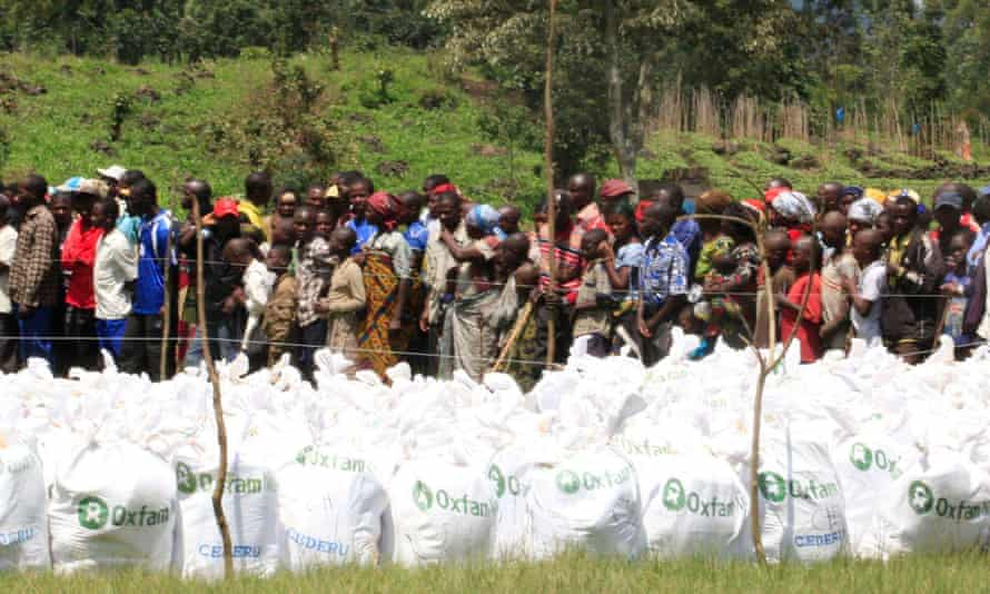 Conflict-affected Villagers Line-up for Assistance from Oxfam - Photo The Guardian