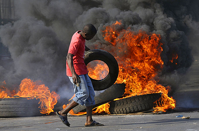 Flaming Tires Block Traffic during the 2010 Riots Over Bread Prices - Photo Al Jazeera