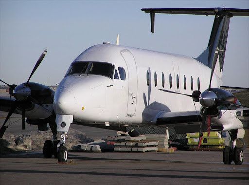 A Beechcraft 1900 on the Runway - Photo Aviation Zenith
