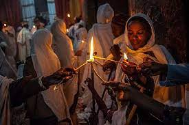 A Woman Reads Scriptures During Ethiopian Easter Celebrations - Photo Pinterest