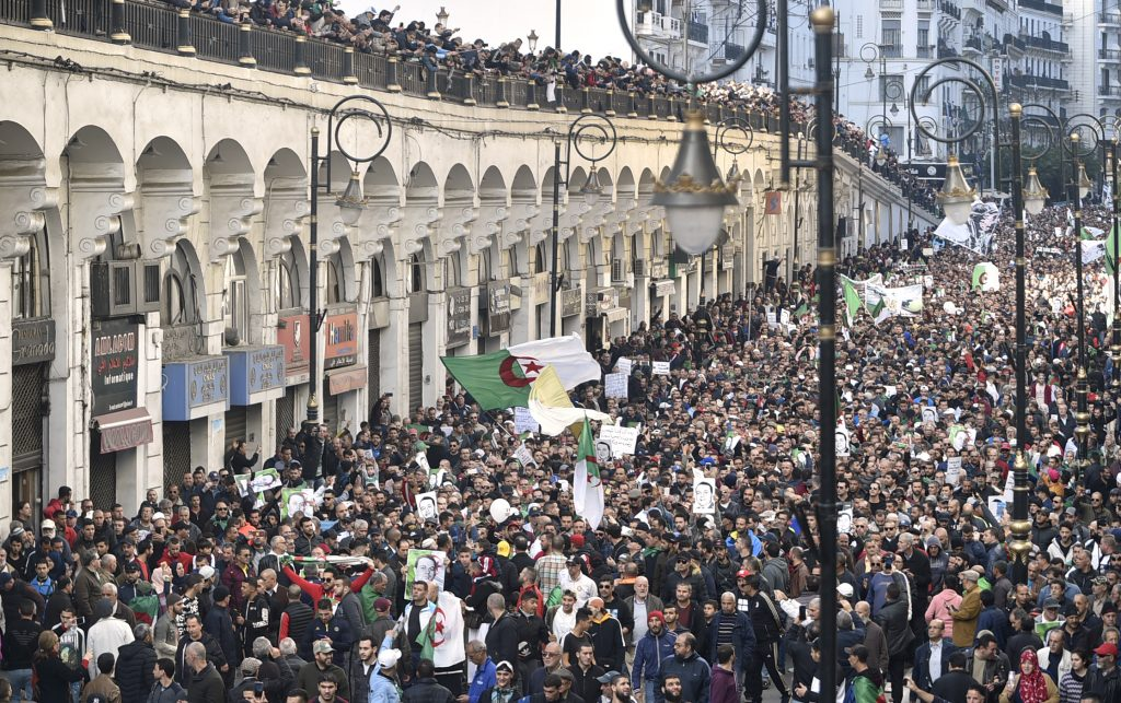 Algerian protesters in an anti-government demonstration in Algiers - Photo Ryad Kramdi, AFP