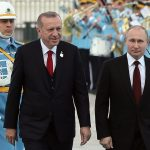 The President of Turkey Recep Tayyip Erdogan (L) and his Russian counterpart Russia's Vladimir Putin review the honor guard - Photo Ade Altan, AFP