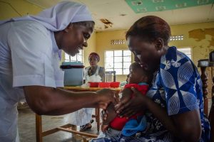 A Reverend Sister Attends to a Patient in South Sudan - Photo East Coast Radio