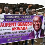 """Fans with an """"Akwaba"""" (Welcome) Banner at Yopougon, Abidjan, on 17 June 2021 - Photo Sia Kambou, AFP"""
