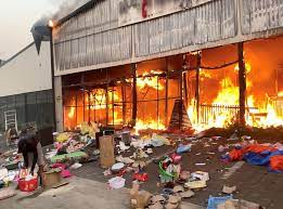 Shops Have Been Looted and Some Torched - Photo Independent UK