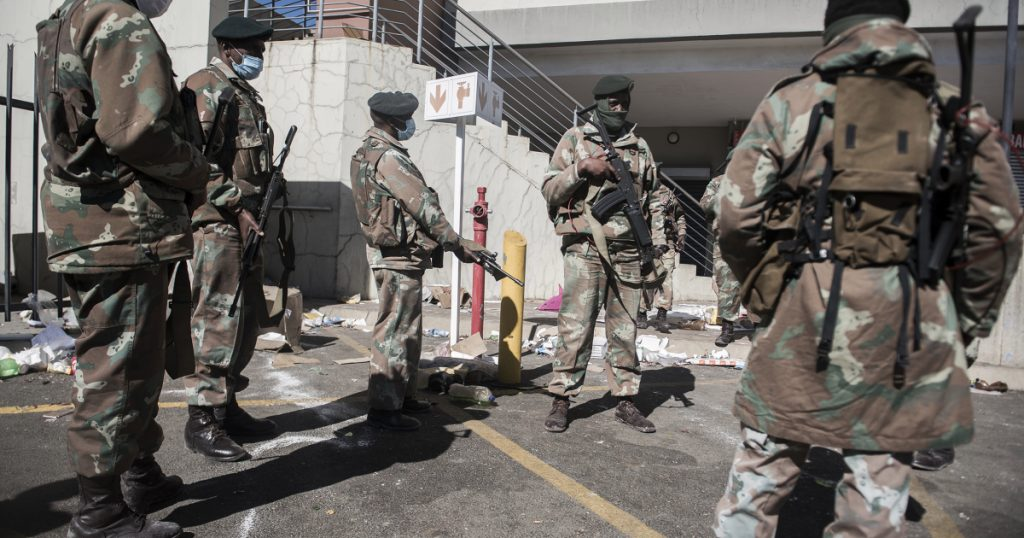 South African National Defense Force (SANDF) members patrol at streets and looted places on 13 July 2021 - Photo Shiraaz Mohamed - Anadolu Agency